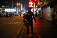 "A protester dressed as the super hero character Captain America walks along the street during a rally in Hong Kong on Sunday, Oct. 27, 2019. Hong Kong police fired tear gas Sunday to disperse a rally called over concerns about police conduct in monthslong pro-democracy demonstrations, with protesters cursing the officers and calling them ""gangster cops."" (AP Photo/Kin Cheung)"