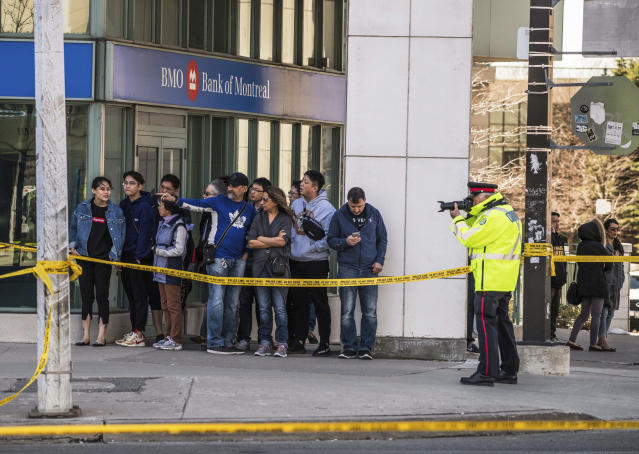 <p>Emergency services close Yonge Street in Toronto after a van mounted a sidewalk crashing into a number of pedestrians on Monday, April 23, 2018. (Photo: Aaron Vincent Elkaim/Canadian Press) </p>