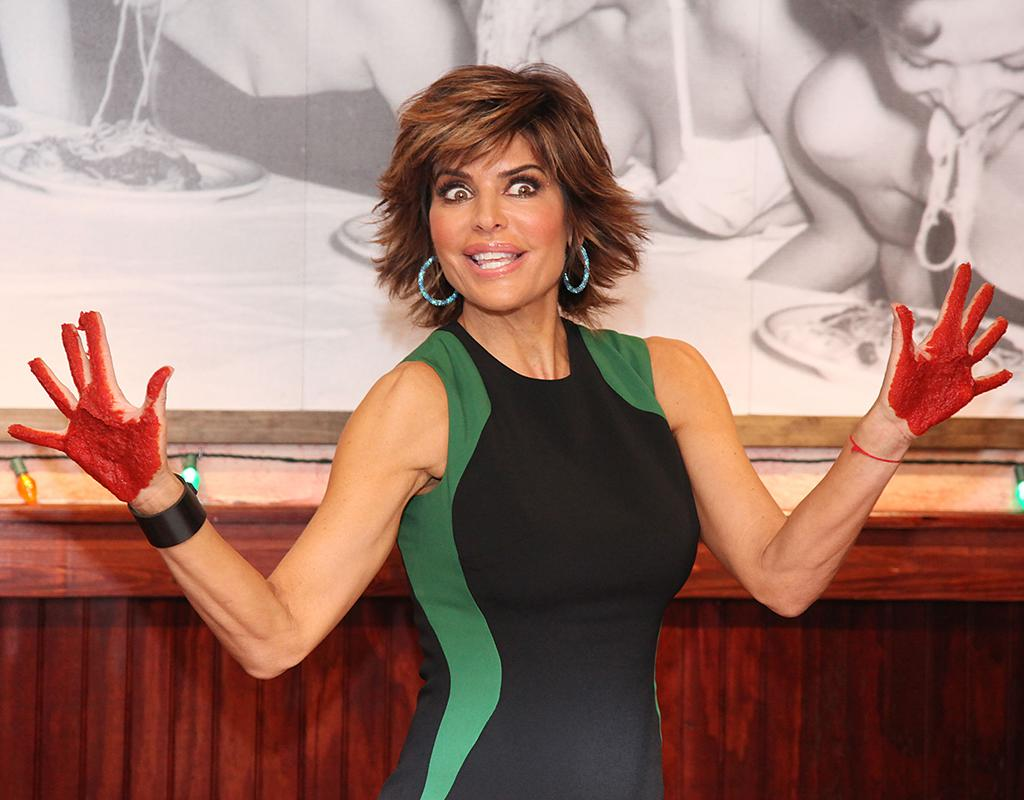 She may never get to be honored with a hand and footprint ceremony at Grauman's Chinese Theatre, but actress Lisa Rinna got a different kind of honor on Monday. She participated in a marinara sauce handprint ceremony at Italian chain Bucca di Beppo's New York City outpost. Looked, er, messy! (5/13/2013)