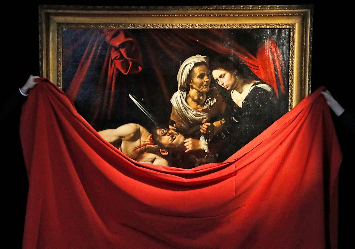 The Caravaggio' Judith and Holfernes, painting is unveiled at the Colnaghi Gallery in London, Thursday, February 28, 2019. The Caravaggio' Judith and Holfernes, lost in Amsterdam in 1617 has since been rediscovered in an attic in a Toulouse farmhouse in 2014.