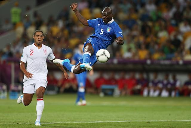KIEV, UKRAINE - JUNE 24: Mario Balotelli of Italy strikes the ball as Glen Johnson of England looks on during the UEFA EURO 2012 quarter final match between England and Italy at The Olympic Stadium on June 24, 2012 in Kiev, Ukraine. (Photo by Scott Heavey/Getty Images)
