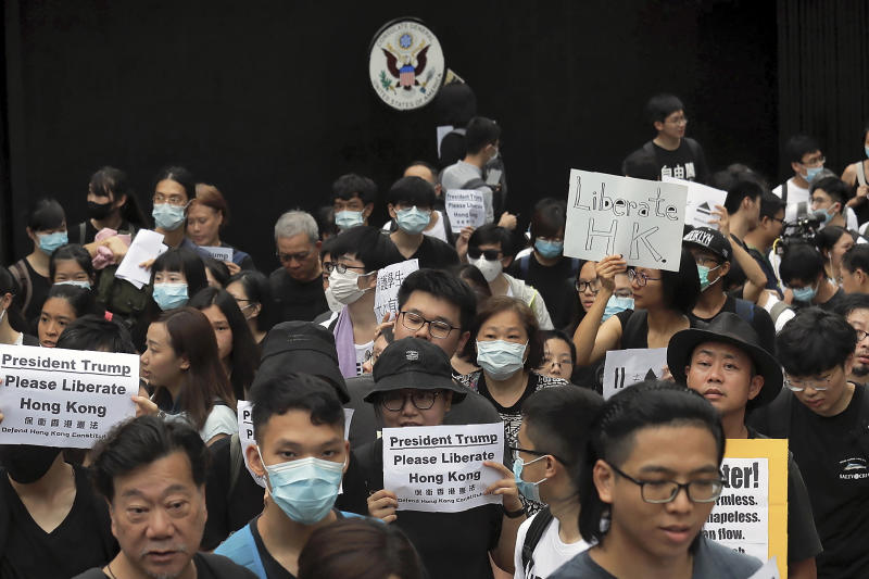Protesters gather outside the U.S. Consulate as they stage a protest in Hong Kong, Wednesday, June 26, 2019. Hong Kong activists opposed to contentious extradition legislation on Wednesday called on leaders of the U.S., the European Union and others to raise the issue with Chinese President Xi Jinping at this week's G-20 summit in Japan. (AP Photo/Kin Cheung)