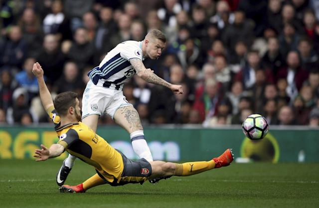 <p>West Bromwich Albion's James McClean shoots as Arsenal's Shkodran Mustafi attempts to block </p>