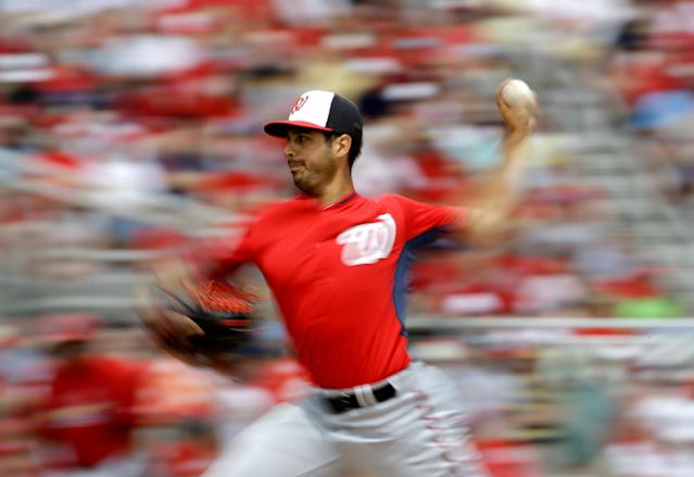 In this photo taken with a slow shutter speed, Washington Nationals starting pitcher Gio Gonzalez throws in the first inning of an exhibition spring training baseball game against the St. Louis Cardinals, Friday, March 21, 2014, in Jupiter, Fla. (AP Photo/David Goldman)
