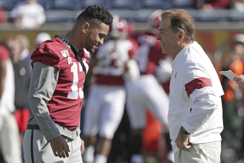 Alabama quarterback Tua Tagovailoa, left, talks with Alabama head coach Nick Saban before the Citrus Bowl on Jan. 1, 2020, in Orlando, Florida. (AP Photo/John Raoux)