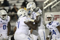 Tulsa wide receiver Sam Crawford Jr. (9) is congratulated by offensive tackle Chris Paul (71), running back Deneric Prince (8) and wide receiver Malik Rodgers (84) after Crawford scored on a pass reception during the second half of the team's NCAA college football game against Central Florida, Saturday, Oct. 3, 2020, in Orlando, Fla. (AP Photo/Phelan M. Ebenhack)