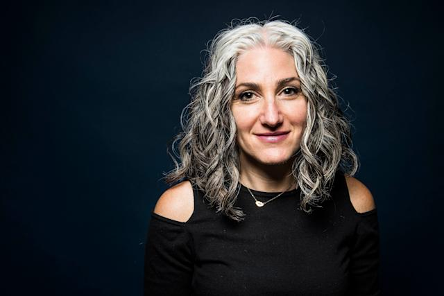 """""""I started going gray at about 19. It was just a little streak, and it stayed that way for a long time until my 30s when it started going a little more. I actually loved it. My father had a thick head of wavy white hair that he loved, and I just felt like it was natural highlights. I never had a negative feeling about it. Now, I'm almost like a bartender. Women come up to meto show me their roots and tell me their sob stories."""""""