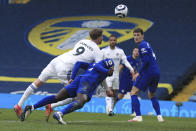 Leeds United's Patrick Bamfordheads the ball during the English Premier League soccer match between Leeds United and Chelsea at Elland Road stadium, in Leeds, England, Saturday, March 13, 2021. (Lindsey Parnaby/Pool via AP)