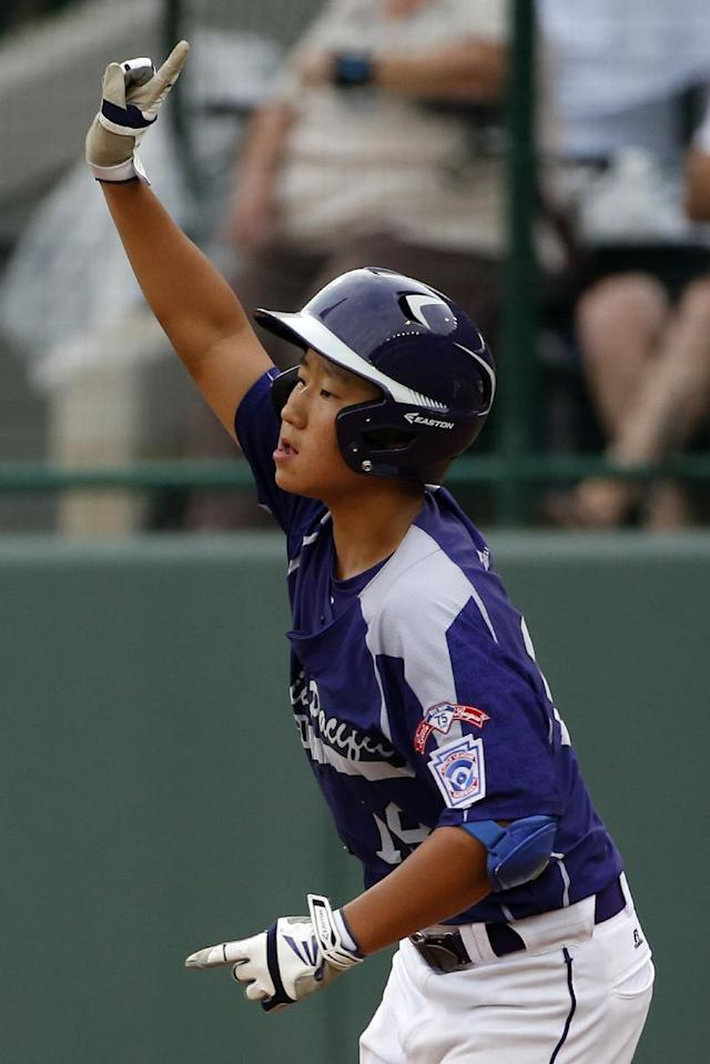 CORRECTS DATE AND YEAR TO AUG. 20, 2014 - Seoul's Jae Yeong Hwang (18) rounds first after hitting a solo home run off Tokyo pitcher Suguru Kanamori in the sixth inning of a International semi-final baseball game against Tokyo at the Little League World Series tournament in South Williamsport, Pa., Wednesday, Aug. 20, 2014. Seoul won 4-2. (AP Photo/Gene J. Puskar)