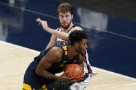 West Virginia's Derek Culver goes to the basket against Gonzaga's Drew Timme during the second half of an NCAA college basketball game Wednesday, Dec. 2, 2020, in Indianapolis. (AP Photo/Darron Cummings)