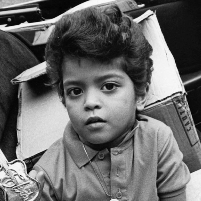 <p>Bruno Mars was born in Honolulu, Hawaii as Peter Hernandez. Here, he's shown as a four year old Elvis impersonator in August 1990 in Memphis, TN. A baby Elvis, how cute!</p>