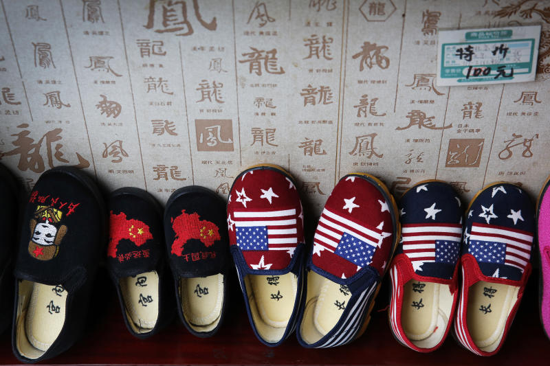 Chinese made children shoes carrying a Chinese map and U.S. flags are on display for a sale at a shop in Beijing. China announced it filled a World Trade Organization challenge Monday