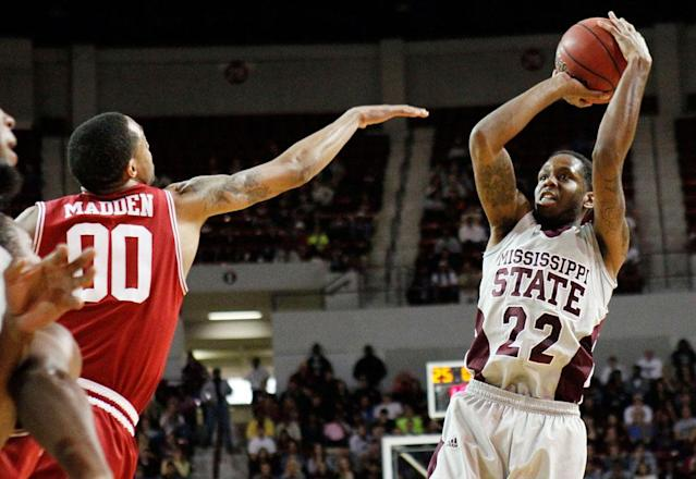 Mississippi State guard Brian Bryant (22) shoots past Arkansas guard Rashad Madden (0) during the second half of their NCAA college basketball game, Saturday, March 3, 2012, in Starkville, Miss. Mississippi State won 79-59.