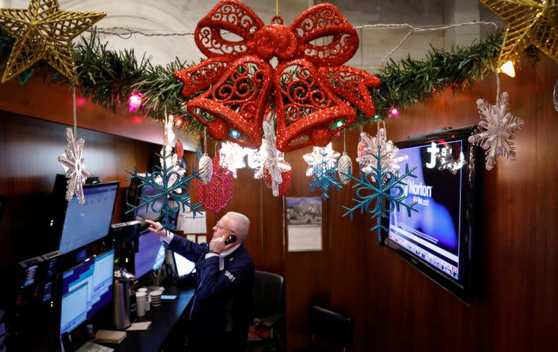 A trader works at his stall on the floor at the NYSE in New York