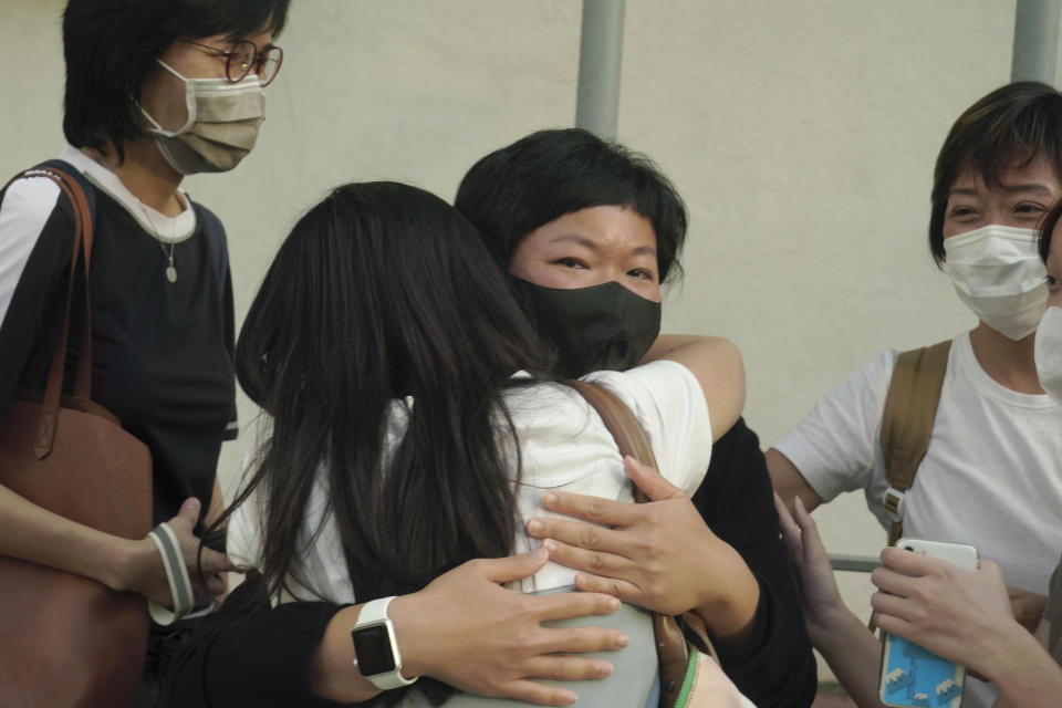 Hong Kong journalist Choy Yuk-ling, center, also known as Bao Choy, reacts outside a court in Hong Kong Thursday, April 22, 2021. The Hong Kong journalist was fined 6,000 Hong Kong dollars ($775) on Thursday after being found guilty of making false statements while obtaining information from a vehicle database, in the latest blow to press freedom in the city as authorities continue their crackdown on dissent. (AP Photo/Kin Cheung)