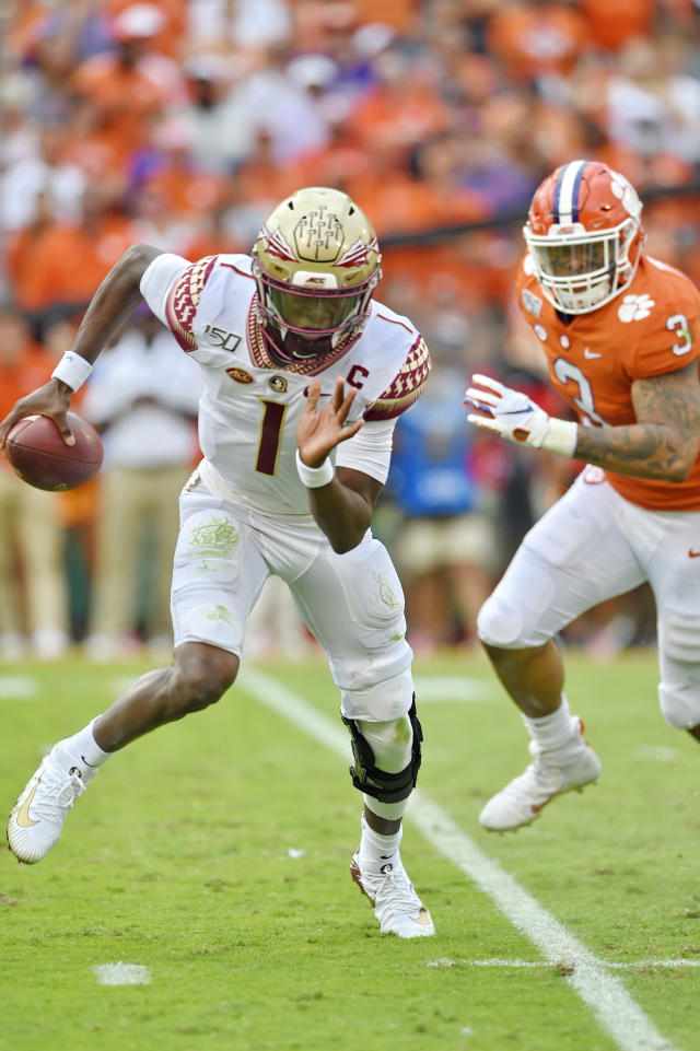 Florida State quarterback James Blackman (1) scrambles out of the pocket under pressure by Clemson's Xavier Thomas during the first half of an NCAA college football game Saturday, Oct. 12, 2019, in Clemson, S.C. (AP Photo/Richard Shiro)