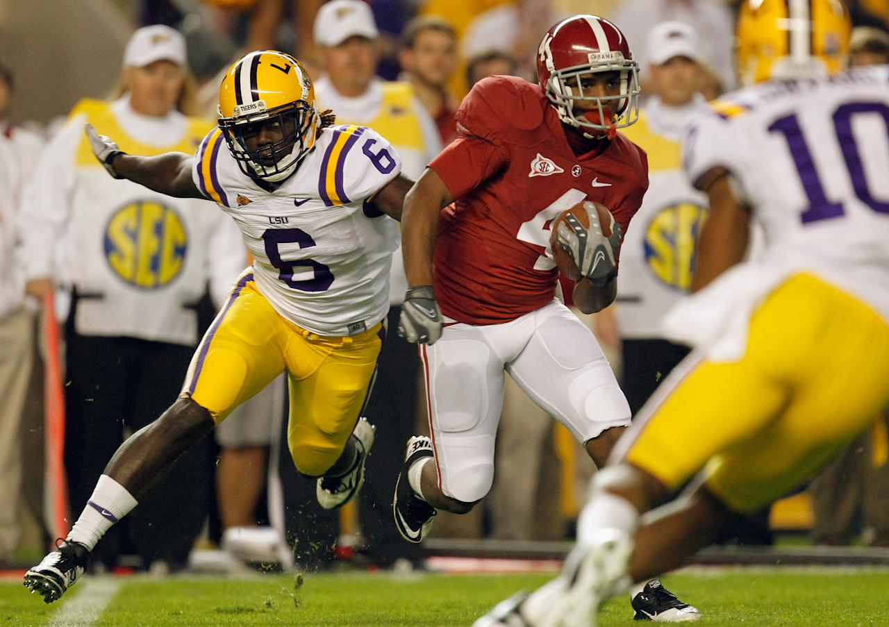 TUSCALOOSA, AL - NOVEMBER 05:  Marquis Maze #4 of the Alabama Crimson Tide returns a kick-off and runs from Craig Loston #6 of the LSU Tigers during the first half of the game at Bryant-Denny Stadium on November 5, 2011 in Tuscaloosa, Alabama.  (Photo by Streeter Lecka/Getty Images)
