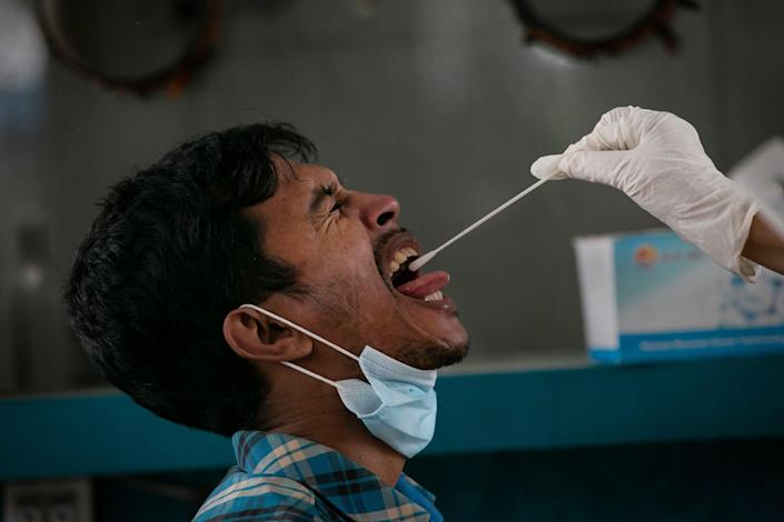 A man is tested for COVID during a countrywide lockdown on July 4, 2021, in Dhaka, Bangladesh.