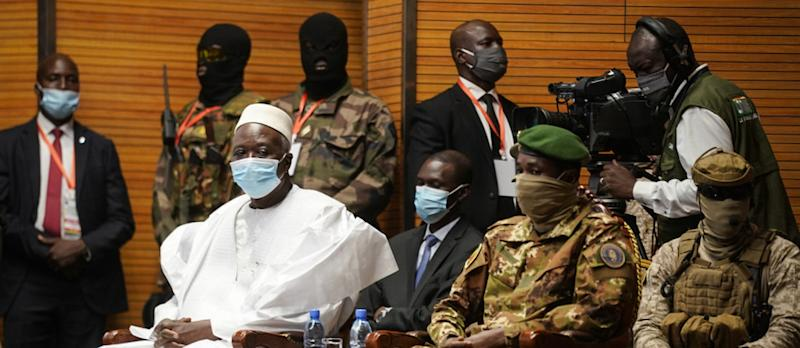 Transition Mali President Bah Ndaw (L) is seen with during his swearing-in ceremony at the CICB (Centre International de Conferences de Bamako) in Bamako on September 25, 2020. - This inauguration is expected to mark the beginning of a transition period of several months in preparation for general elections and the return of civilians to lead the country. (Photo by Michele Cattani / AFP), Transition Mali President Bah Ndaw (L) is seen with during his swearing-in ceremony at the CICB (Centre International de Conferences de Bamako) in Bamako on September 25, 2020. - This inauguration is expected to mark the beginning of a transition period of several months in preparation for general elections and the return of civilians to lead the country. (Photo by Michele Cattani / AFP)