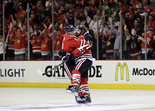 Chicago Blackhawks defenseman Brent Seabrook, right, celebrates his goal against the Anaheim Ducks with Jonathan Toews during the third period in Game 4 of the Western Conference finals of the NHL hockey Stanley Cup playoffs, Saturday, May 23, 2015, in Chicago. (AP Photo/Nam Y. Huh)