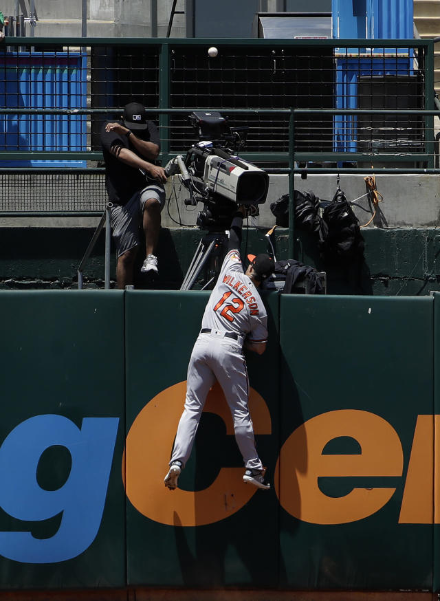 Baltimore Orioles left fielder Stevie Wilkerson (12) cannot catch a three-run home run hit by Oakland Athletics' Josh Phegley during the fifth inning of a baseball game in Oakland, Calif., Wednesday, June 19, 2019. (AP Photo/Jeff Chiu)