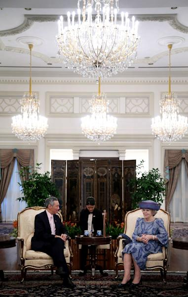 Queen Beatrix of the Netherlands sits with Singapore's Prime Minister Lee Hsien Loong, left, on Thursday Jan. 24, 2013 at the Istana or presidential palace in Singapore during her official four-day state visit to the country. (AP Photo/Wong Maye-E)