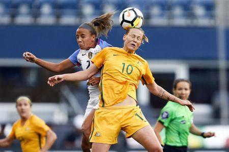 Jul 27, 2017; Seattle, WA, USA; Australia midfielder Emily Van Egmond (10) and USA midfielder Mallory Pugh jump for a header during the first half at Century Link Field. Mandatory Credit: Joe Nicholson-USA TODAY Sports