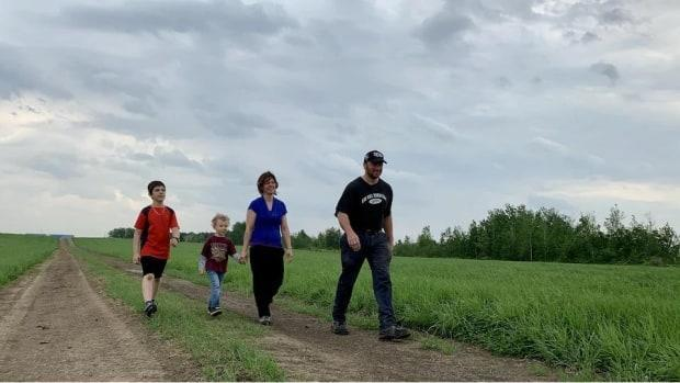 Sébastien Grondin walks with his family on the land, Ferme Valsé in the Pintendre sector of Lévis, Que.