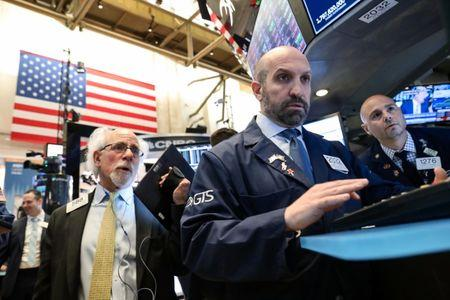 Traders work on the floor at the New York Stock Exchange (NYSE) in New York, U.S., April 24, 2019. REUTERS/Brendan McDermid
