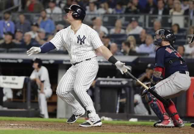 New York Yankees' Luke Voit follows through on a two-run home run during the second inning of a baseball game against the Boston Red Sox on Thursday, Sept. 20, 2018, in New York. (AP Photo/Frank Franklin II)