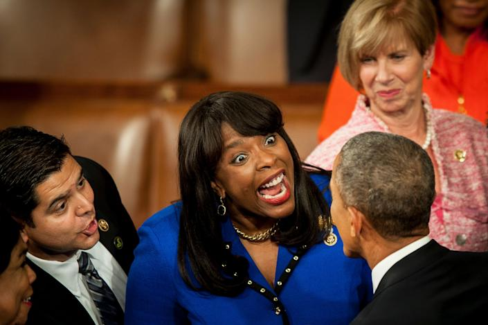 President Barack Obama, bottom right, is greeted by Rep. Terri Sewell (D-Ala.), center, as he arrives to deliver the State of the Union address to a joint session of Congress on Jan. 20, 2015.