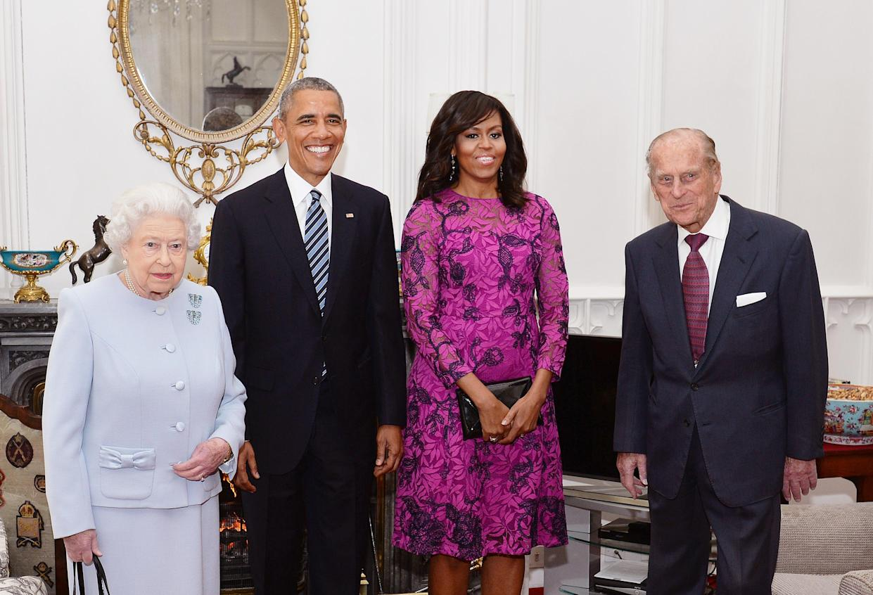 (L-R) Britain's Queen Elizabeth II, US President Barack Obama, US First Lady Michelle Obama and Prince Philip, Duke of Edinburgh, pose for a photograph in the Oak Room ahead of a private lunch at Windsor Castle in Windsor, southern England, on April, 22, 2016.  / AFP / POOL / John Stillwell        (Photo credit should read JOHN STILLWELL/AFP/Getty Images)