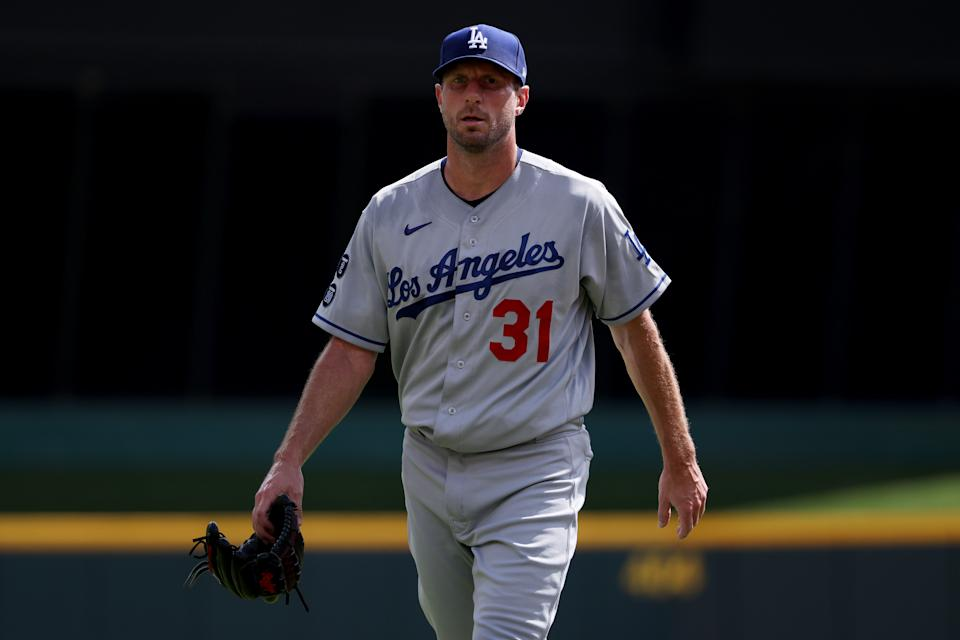 CINCINNATI, OHIO - SEPTEMBER 18: Max Scherzer #31 of the Los Angeles Dodgers walks across the field before the game against the Cincinnati Reds at Great American Ball Park on September 18, 2021 in Cincinnati, Ohio. (Photo by Dylan Buell/Getty Images)