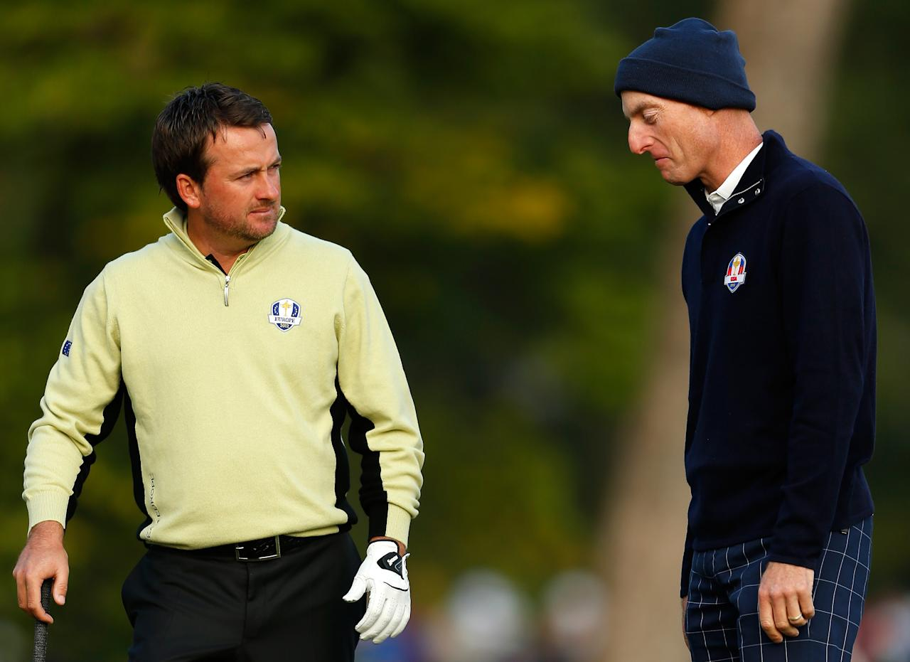 MEDINAH, IL - SEPTEMBER 28:  Graeme McDowell of Europe (L) and Jim Furyk of the USA discuss the position of McDowell's golf ball on the second hole during the Morning Foursome Matches for The 39th Ryder Cup at Medinah Country Club on September 28, 2012 in Medinah, Illinois.  (Photo by Jamie Squire/Getty Images)