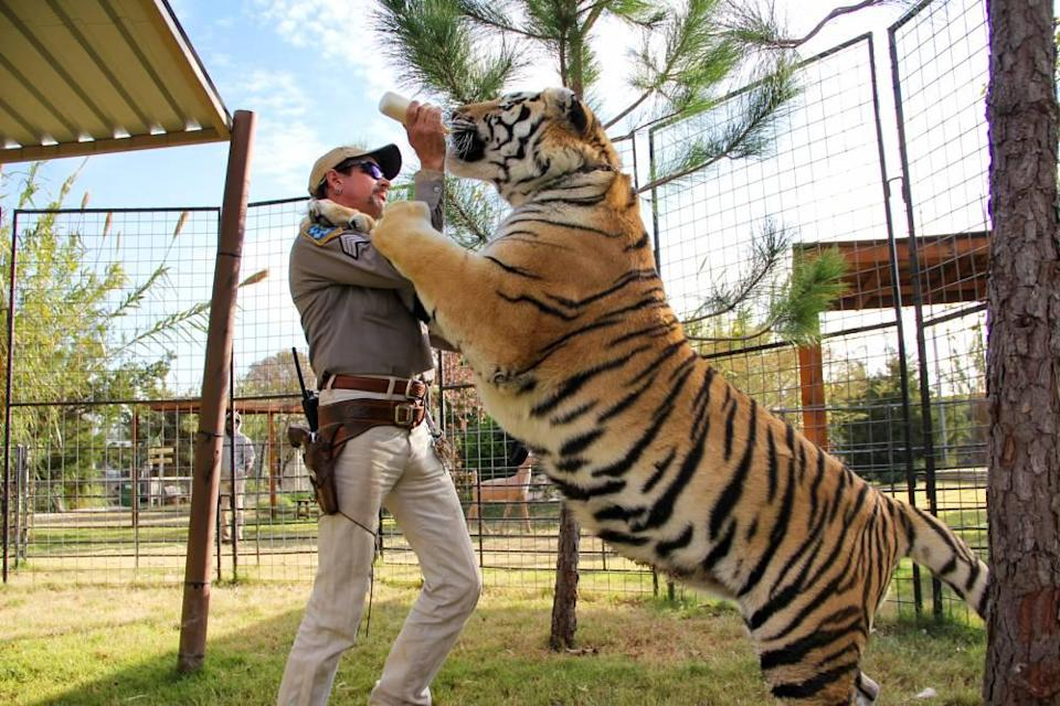 Joe Exotic feeds a tiger at his zoo near Wynnewood, Okla. Exotic is now serving a 22-year sentence in federal prison.