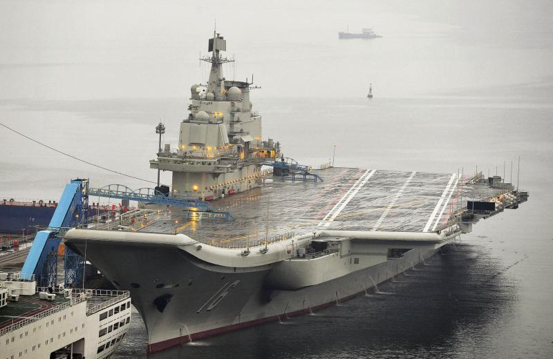 China's first aircraft carrier, which was renovated from an old aircraft carrier that China bought from Ukraine in 1998, is seen docked at Dalian Port, Liaoning province, in this September 22, 2012 file photo. A lack of detailed operational guidelines between the Chinese military and the United States and its allies is heightening fears that a miscalculation or mishap across Asia's crowded seas and skies could get out of control. When a U.S. guided missile cruiser shadowing China's only aircraft carrier in the South China Sea earlier this month was forced to change course to avoid hitting a smaller Chinese warship, it was seen as the latest sign of how dangerously closely the two navies now operate. REUTERS/Stringer/Files (CHINA - Tags: MILITARY POLITICS) CHINA OUT. NO COMMERCIAL OR EDITORIAL SALES IN CHINA