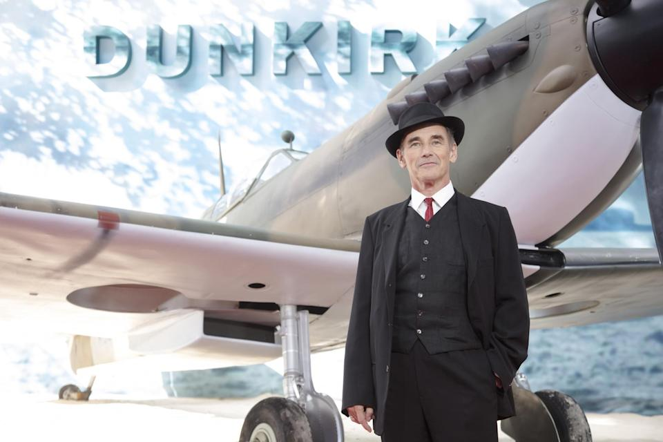<p>Sir Mark Rylance posing in front of a Spitfire (WB) </p>