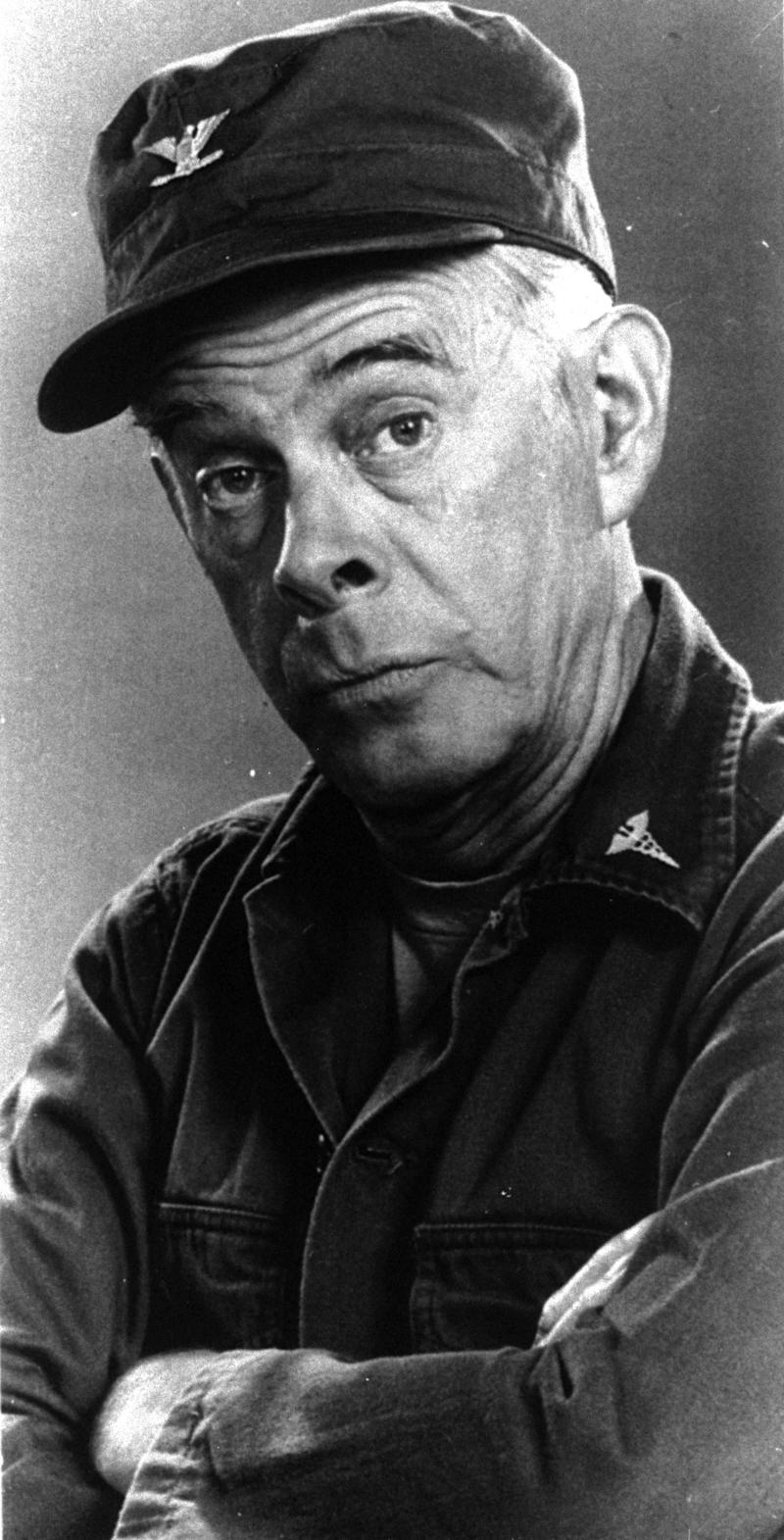 """FILE - In this 1976 handout photo, Harry Morgan poses on the set of his television show """"MASH,""""   The Emmy-winning character actor whose portrayal of the fatherly Col. Potter on television's """"M*A*S*H"""" highlighted a show business career that included nine other TV series, 50 films and the Broadway stage, died Wednesday, Dec. 7, 2011. He was 96.  Morgan appeared in mostly supporting roles on the big screen, playing opposite such stars as Henry Fonda, John Wayne, James Garner, Elvis Presley and Dan Aykroyd. On television, he was more the comedic co-star, including roles on """"December Bride,"""" its spin-off """"Pete and Gladys,"""" as Sgt. Joe Friday's loyal partner in later """"Dragnet"""" episodes and on CBS-TV's long-running """"M-A-S-H"""" series, for which he earned an Emmy award in 1980.  (AP Photo)"""