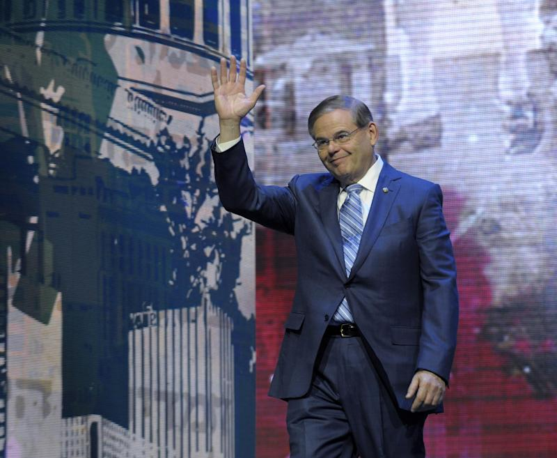 Senate Foreign Relations Committee Chairman Sen. Robert Menendez, D-N.J., waves as he arrives to address the American-Israeli Public Affairs Committee (AIPAC) 2013 Policy Conference at the Walter E. Washington Convention Center in Washington, Tuesday, March 5, 2013. Menendez, who has maintained that he never paid prostitutes for sex, said he is looking forward to whatever evidence emerges from courts in the Dominican Republic to vindicate him.  (AP Photo/Susan Walsh)