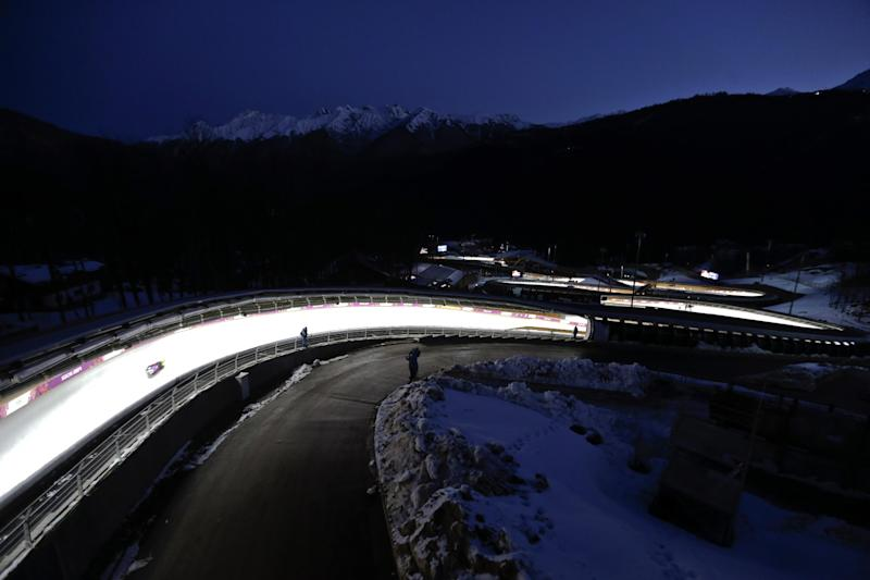 David Moeller of Germany takes a turn during a training session for the men's singles luge at the 2014 Winter Olympics, Friday, Feb. 7, 2014, in Krasnaya Polyana, Russia. (AP Photo/Natacha Pisarenko)
