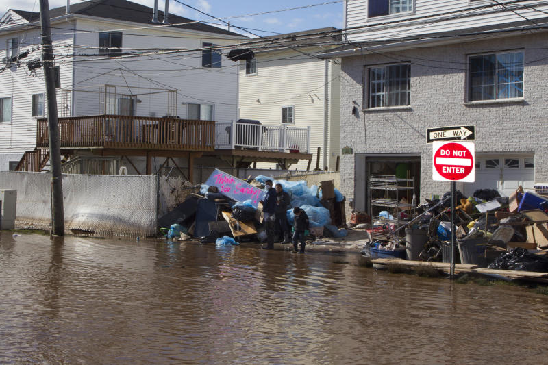 A family cleans up after Hurricane Sandy's surging waters flooded their home in the Midland Beach section of Staten Island