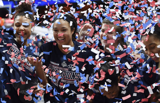 From left to right, Connecticut's Olivia Nelson-Ododa, Napheesa Collier, Crystal Dangerfield, Kyla Irwin and Megan Walker celebrate their win in an NCAA college basketball game against Central Florida in the American Athletic Conference women's tournament finals Monday, March 11, 2019, at Mohegan Sun Arena in Uncasville, Conn. (AP Photo/Jessica Hill)