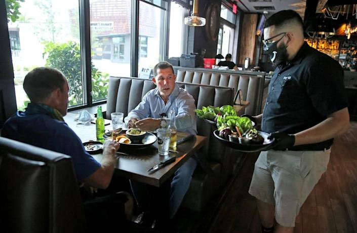 Workers at restaurants throughout South Florida have suffered job losses and reduced hours. Restaurants, including Tap 42 in Doral, were allowed to reopen at limited capacity in May.