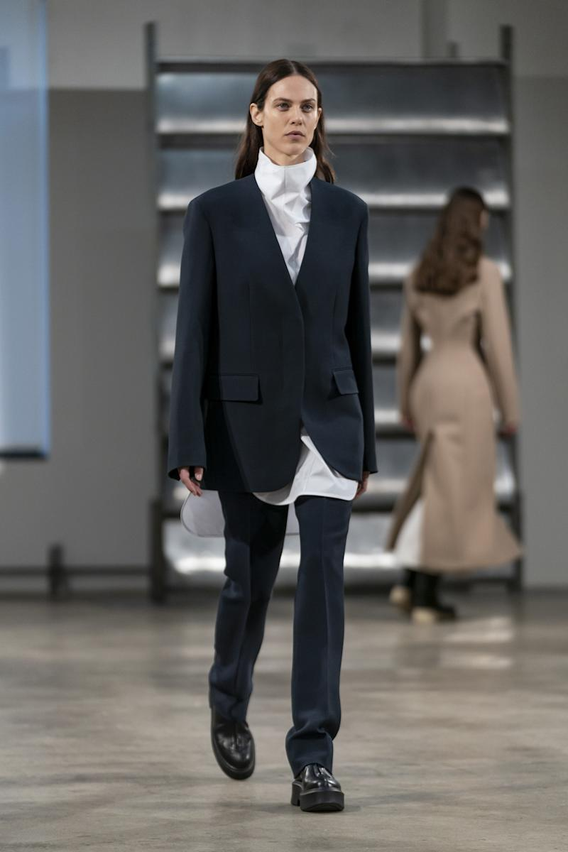 An untucked shirt loosens up an otherwise classic suit in The Row's Fall 2019 show.