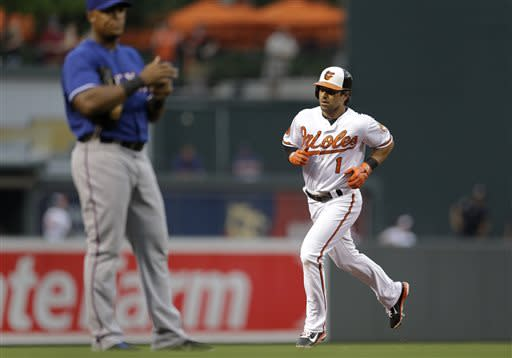 Baltimore Orioles' Brian Roberts rounds the bases after hitting a solo home run in the third inning of a baseball game against the Texas Rangers, Thursday, July 11, 2013, in Baltimore. (AP Photo/Patrick Semansky)