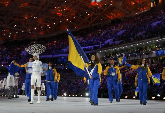 Bosnia and Herzegovina's flag-bearer Zana Novakovich leads her country's delegation during the opening ceremony of the 2014 Sochi Winter Olympic Games at Fisht stadium February 7, 2014. REUTERS/Brian Snyder (RUSSIA - Tags: OLYMPICS SPORT)