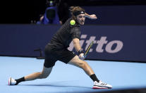 Greece's Stefanos Tsitsipas returns a shot to Austria's Dominic Thiem, during their London 2020 group singles match on day one of the ATP Finals tennis championship at The O2 Arena, London, Sunday Nov. 15, 2020. (John Walton/PA via AP)