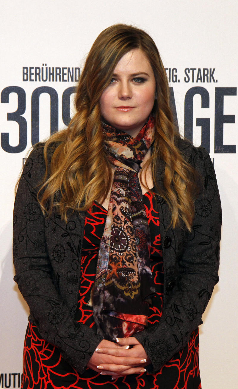 "Austrian Natascha Kampusch poses for photographers before the premiere of the film ""3096 Days"" in Vienna, Austria, Monday Feb. 25, 2013.  The film tells the story of Kampusch who was abducted as a schoolgirl and held prisoner in a cellar for almost nine years. (AP Photo/Ronald Zak)"