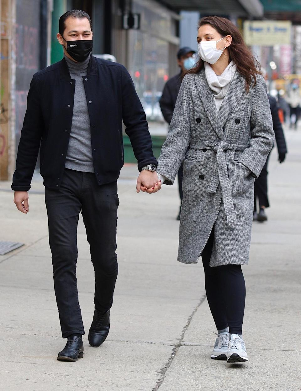 <p>Katie Holmes and Emilio Vitolo Jr. are in great spirits as they make their way to lunch in downtown N.Y.C. on Monday.</p>