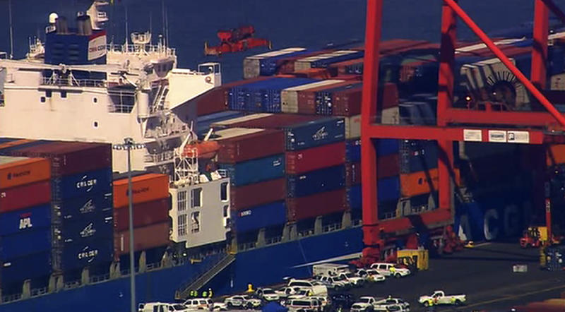 This image made from video provided by Eyewitness News WABC-TV shows an aerial view of a container ship in Newark with suspected stowaways. Dock workers rushed to unload containers stacked on top of one another inside a cargo ship that arrived in New Jersey from the Middle East on Wednesday, June 27, 2012 after Coast Guard officials heard knocking from one during a routine inspection, suggesting that stowaways might be on board. (AP Photo/Eyewitness News WABC-TV) MANDATORY CREDIT